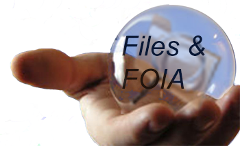 A hand extending a glass ball labeled Files and FOIA to indicate transparency