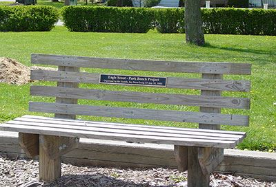 A wooden bench in a park.